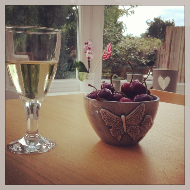 Celebrating the arrival of the weekend with a glass of wine and a bowl of black cherries last night