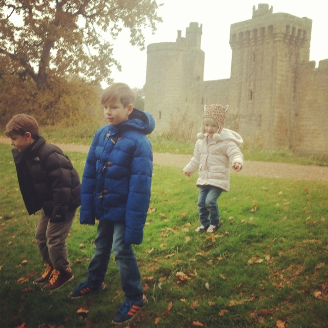The children contemplating whether or not to roll down the muddy hill outside the castle. Luckily they decided not to!