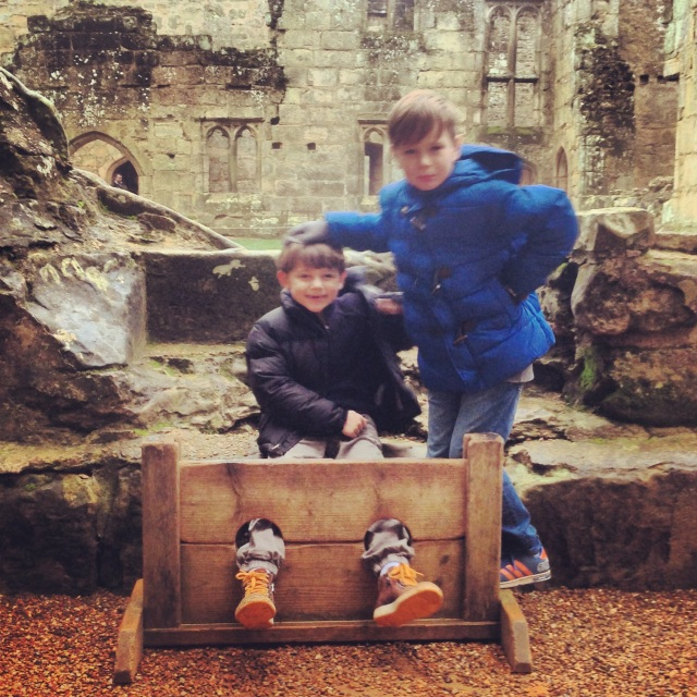 Cameron looks rather pleased to see his brother in the stocks!